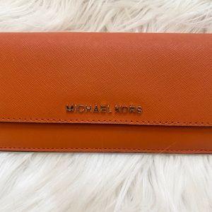 Michael Kors Bags - MICHAEL KORS. ORANGE. PETITE WALLET ❤️❤️❤️